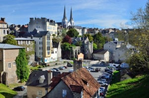 There are traditional townhouses, lush foliage and narrow streets in French town Pau.